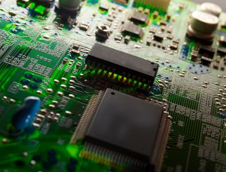 microelectronics: Green electronic board illuminated from bottom