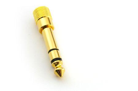 Golden headphone plug isolated on white background photo