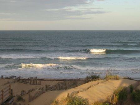 Multiple Waves breaking on beach in relief Фото со стока