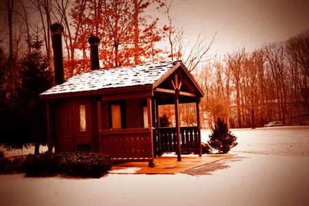 cozy little building in snow Фото со стока
