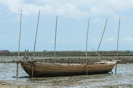 Fisherman boat on sand mud