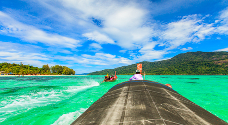 small fisherman boat float in beautiful clear green sea, lipe island, thailand