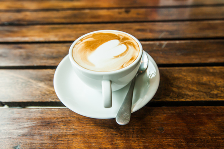 hot latte coffee on grunge wood table Stock Photo