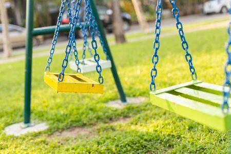 Empty chain swing in children playground Imagens