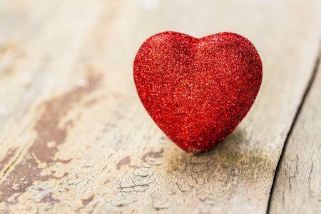 Red valentine heart on grunge wooden background