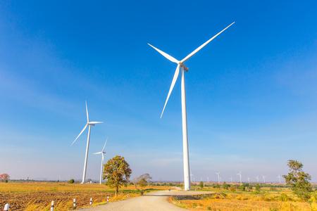 Wind turbine generator farm and blue sky