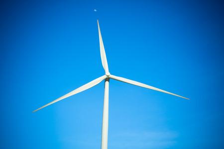 Wind turbine generator on blue sky