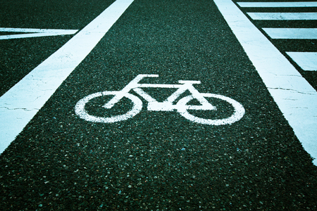 Bicycle sign on asphalt concrete road