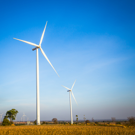 Eco power. Electrical wind mill power generation and blue sky Stock Photo