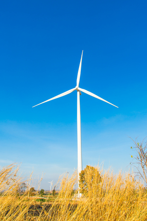 Wind turbine generator on blue sky
