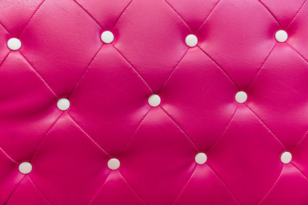 Pink leather sofa pattern background