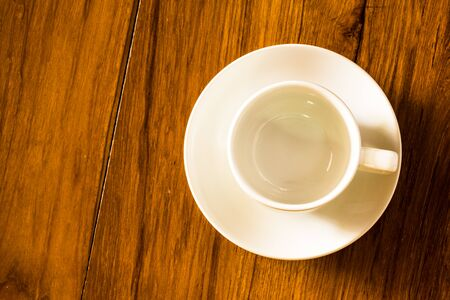 Empty coffee glass on grunge wood background