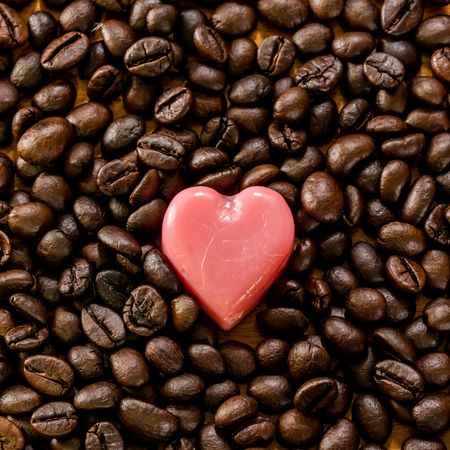 love heart on roasted coffee bean background