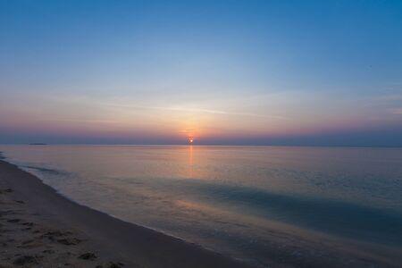 Beautiful sunrise over tropical sea and beach