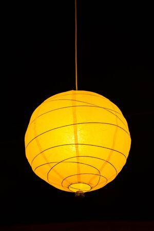 Ceiling lamp glowing in dark Imagens