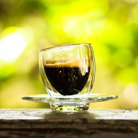 Hot espresso coffee on table