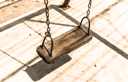 Retro empty wooden swing close up