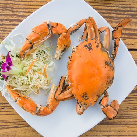 Steam crabs in white plate