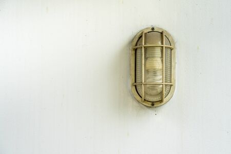 Wall lamp on white concrete Imagens