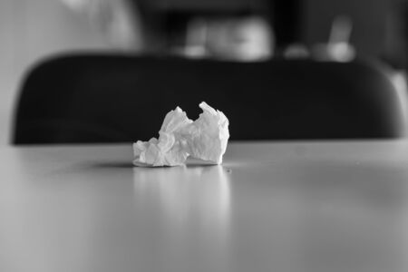 used tissue paper on table. Blank and white photo Imagens