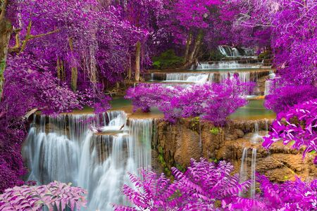 Beautiful waterfall in forest. Autumn filter