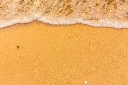 Sea wave flow on soft sand beach