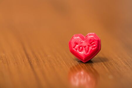 Love heart on wooden table background close up