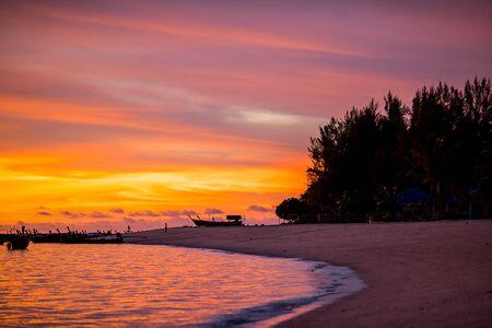 Beautiful sunrise sky over tropical beach and island