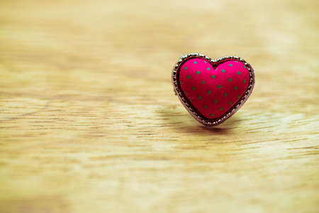 Valentine day background. Red love heart on wooden background
