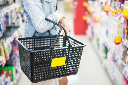 woman shopping in supermarket close up