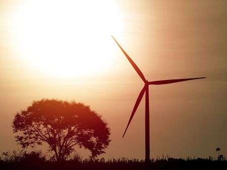 Silhouette wind turbine generator on sunset
