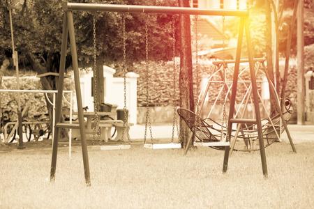 Vintage swing in children playground Stock Photo