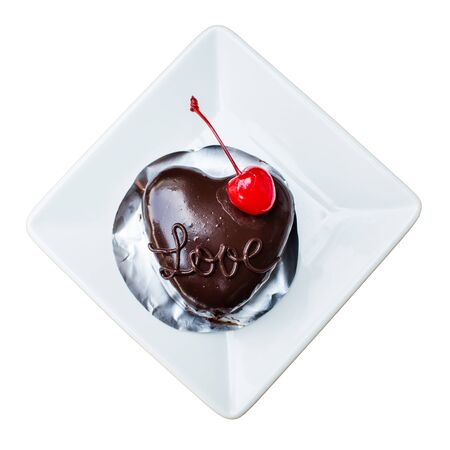 Top view heart shape chocolate cake with cherry on white background Imagens - 134765158