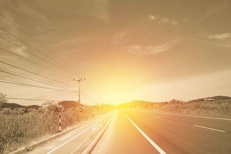 Asphalt road in retro filter Imagens - 134765167