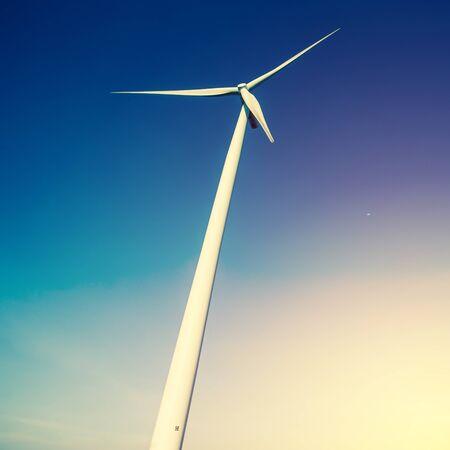 Wind turbine generator on blue sky vintage filter