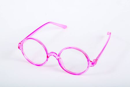 Pink eyeglasses on white background