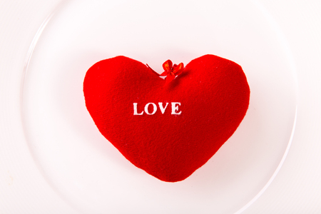 valentine day background. red love heart on white plate