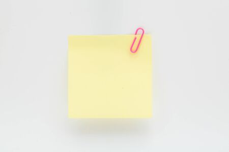 Blank paper note with pink clip for message