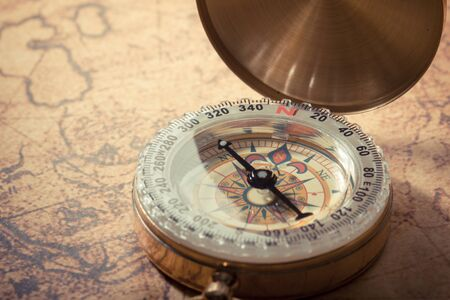Vintage compass on global map Stock Photo