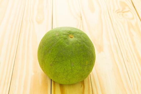 pomelo on wood table