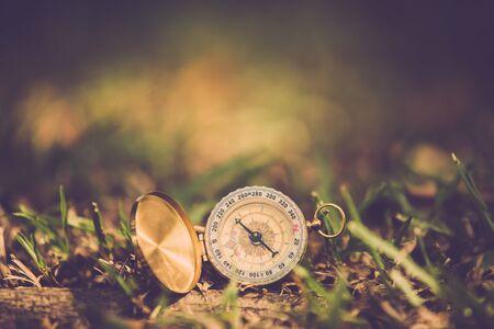 vintage compass on yard close up. vintage filter Stok Fotoğraf