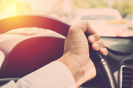 man hand driving car. vintage fiilter