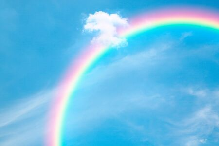 Blue sky and rainbows background