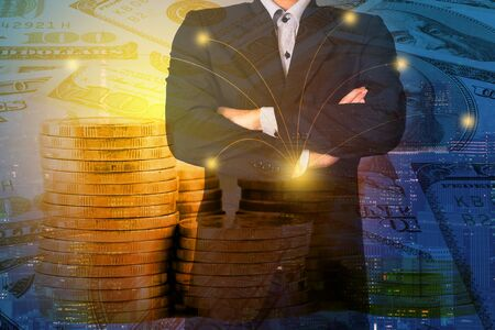 Double exposure businessman on money coins and business networking trading