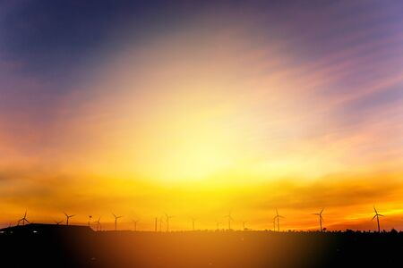 Wind turbine generator farm with sunset sky Imagens