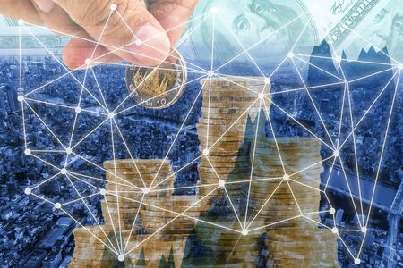 Double exposure business network on money pile coins and city background Imagens - 131768798