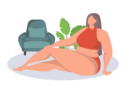 Naked confident woman accept and enjoy herself. A girl with curvaceous forms sits on the floor with his legs crossed and posing.