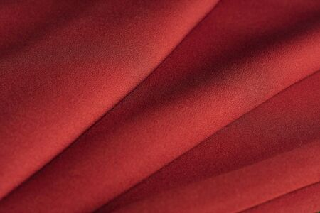 smooth background: Folds of red knitted fabric close-up Stock Photo