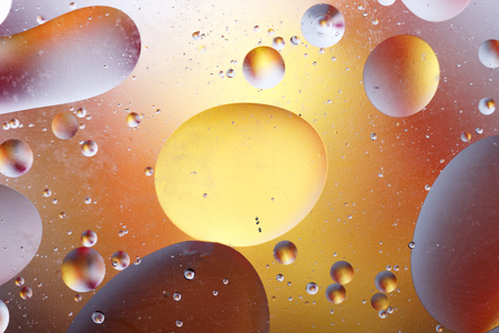 Oil bubbles in an aqueous medium on the border with a glass surface. Abstract Screen Saver.