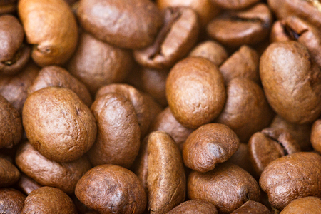 Roasted coffee beans, closeup. Background.